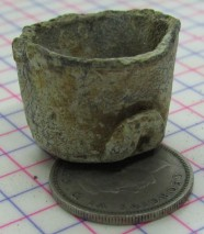 Powder Cap sitting on a sixpence